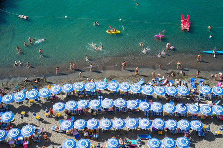 Sorrento, Italy - June 18, 2016: View of the beach and bathers.