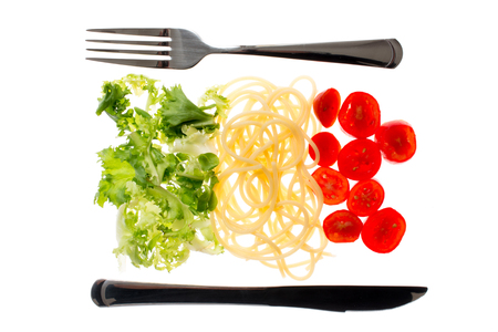 Italian restaurant, food with flag colors. Pasta, lettuce and tomato. Mediterranean diet concept