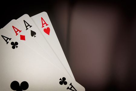 The combination of playing cards poker casino. Four aces on black background