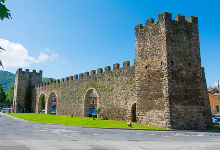 Tourist view of Rieti, in Lazio, Italy. The medieval walls and the gateway Editorial