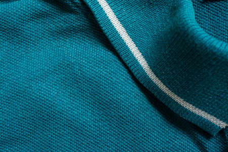 Green polo shirt texture, cotton fabric. Textile background
