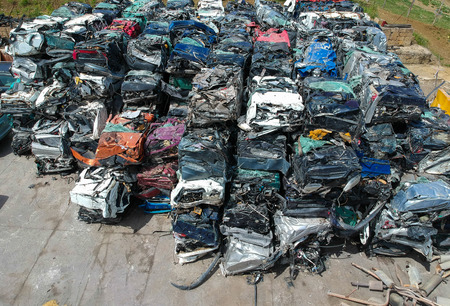 Cars in junkyard, pressed and packed for recycling. Banco de Imagens - 124901129