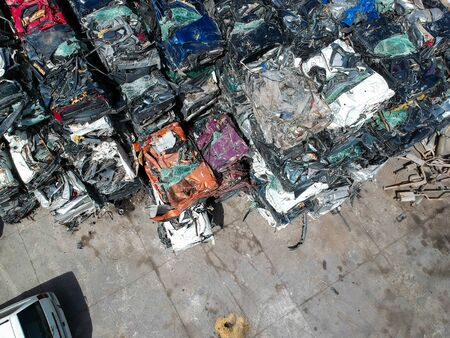 Cars in junkyard, pressed and packed for recycling. Banco de Imagens - 124901941