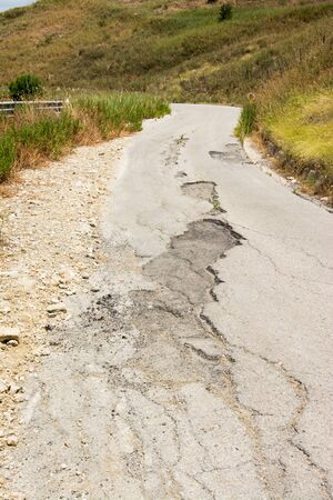 Big pothole on a national road in Sicily caused by landslide, carelessness and abandonment of road maintenance Stock Photo