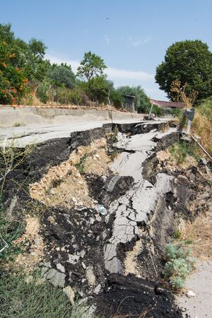Big pothole on a national road in Sicily caused by landslide, carelessness and abandonment of road maintenance