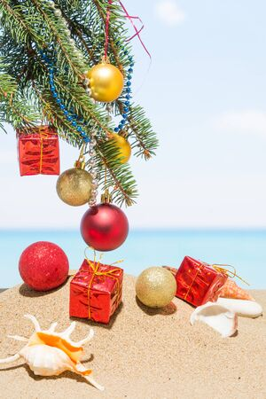 Christmas tree decorations on the beach in tropical. Concept of new year holiday in hot countries