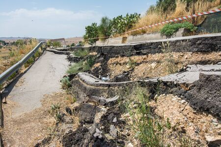 Big pothole on a national road in Sicily caused by landslide, carelessness and abandonment of road maintenance Stock fotó