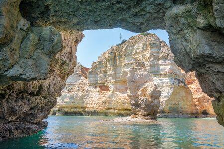 Famous Rocks in Sea, Ocean, Lagos in Portugal. Popular summer travel destination and famous beach at Algarve coastline