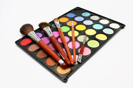 Few blusher put on top of a colorful eyeshadow with white background Stock Photo - 2806802