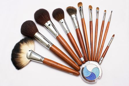 Many different size blusher and the blue white eyeshadow. Stock Photo