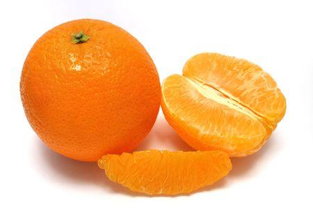 fullness: An fullness orange aligned with peeled orange pieces. Stock Photo