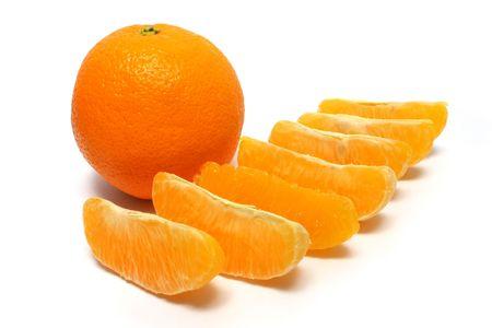fullness: A fullness orange and orange pieces on white background. Stock Photo