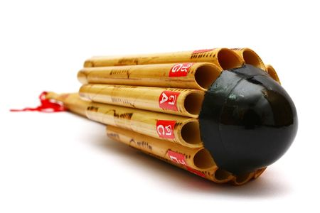 panpipe: The Wot Thai is a circular panpipe used in the music of the Isan region of northeast Thailand. It is part of the bong lang ensemble.