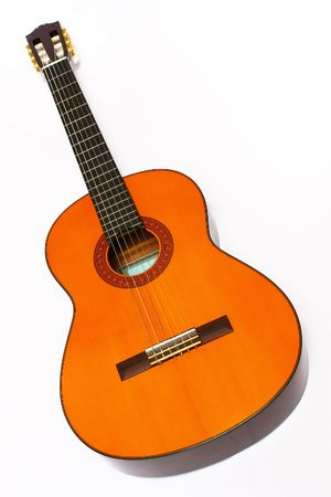 Spanish Guitar or Nylon Guitar lay down on white background. Stock Photo