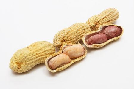 Three well peanuts and peeled peanuts on white background. photo