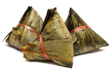 Three rice dumplings (Chinese traditional food) on white background.