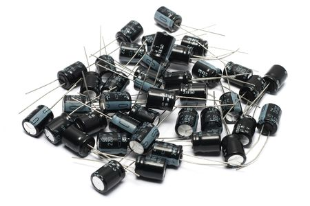 capacitors: A pile of capacitors over white surface.
