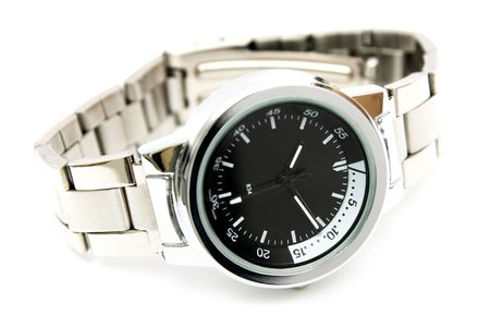 Close-up of a handwatch over white background.