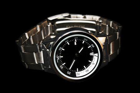 Close-up of a handwatch over black background. Banco de Imagens