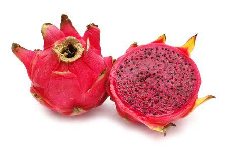 fullness: An half red dragon fruit beside the fullness one.