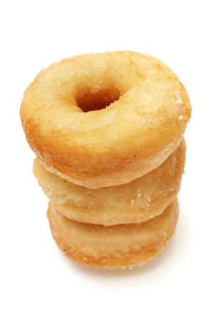Three sweet donuts stacked on white background. photo