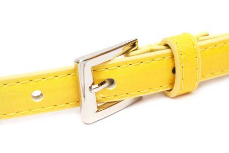 fasten: A fasten yellow belt buckle over white background.