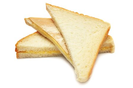 junkfood: A stack of sandwich cut into triangle over white background.