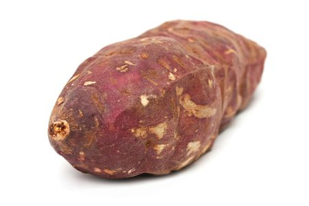 A purple sweet potato isolated on white background. photo