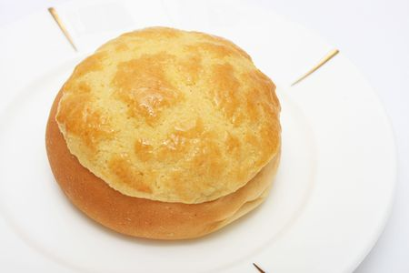 buns: Pineapple bun (Hong Kong pastry) on white plate. Stock Photo