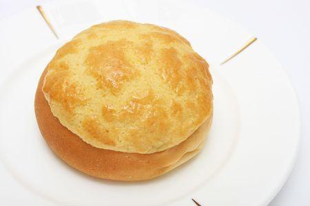 Pineapple bun (Hong Kong pastry) on white plate. Stock Photo