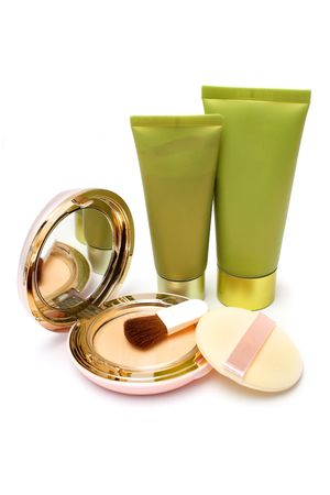 neutrals: Blushers, foundation powder and lotion on white background. Stock Photo