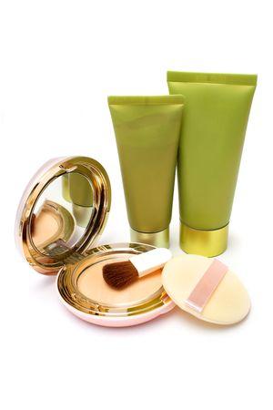irridescent: Blushers, foundation powder and lotion on white background. Stock Photo