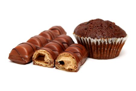 Milk chocolate bars and muffin isolated on white background. photo