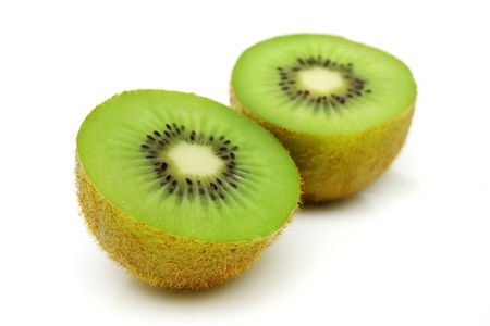 A kiwi fruit sliced into half on white background.