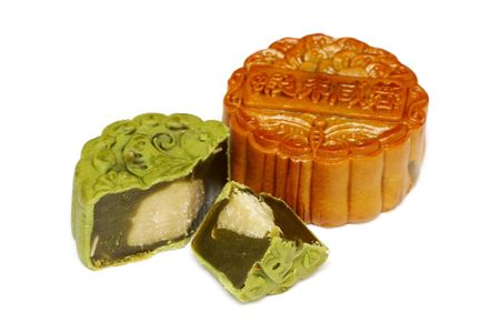 cut and paste: A greentea mooncake slice into pieces over white background. Stock Photo