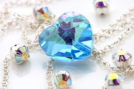 Blue love shape swarovski puts together with silver chain and jewelry.