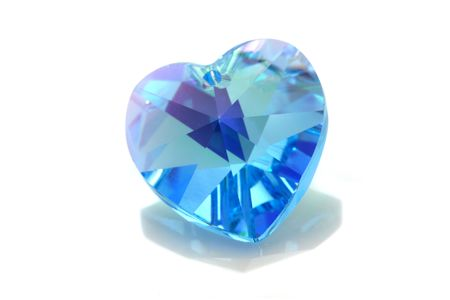 Blue love shape swarovski isolated on white background.