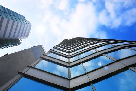 glass building: Perspective view of a blue glass building. Stock Photo