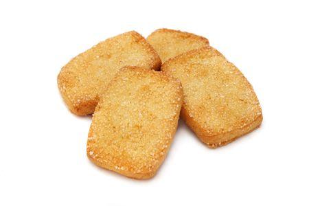 spicecake: Muchas piezas de cookies apilados sobre fondo blanco.