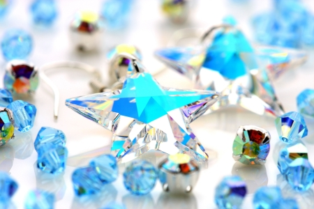 Transparent star shape earrings put together with beads. Stock Photo