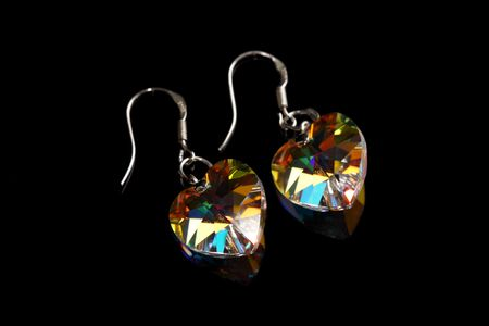 A pair of earrings isolated on black background. photo