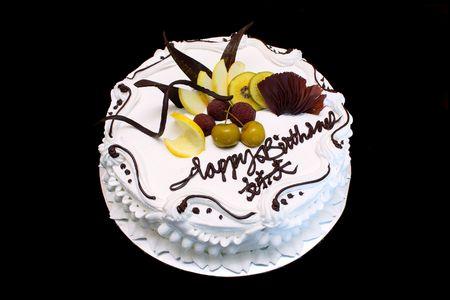 chocolate tart: White birthday cake with cream, fruit and chocolate. Stock Photo