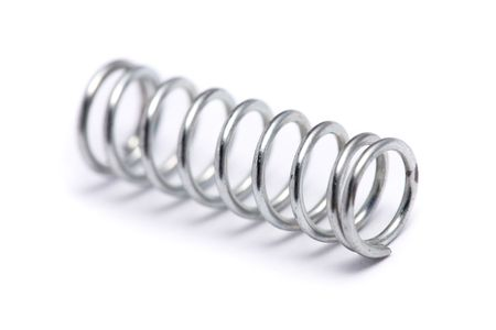 annealed: Close up of a spring coil on white background.