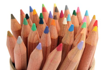 Close up of color pencils with different color over white background. photo