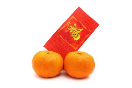 Two oranges and red packet isolated over white background. Stock Photo