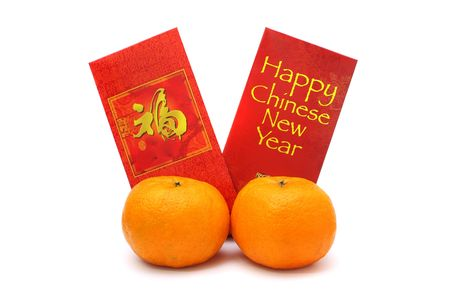Two mandarin oranges and red packets isolated over white background.