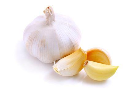 fresh garlic: Close up of white garlics isolated over white background.