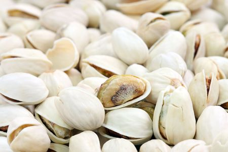 nutshell: Close up of many salted pistachios with nutshell. Stock Photo