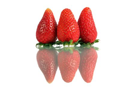 Close up of Korea strawberry standing over white background. photo