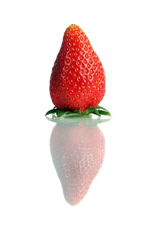 Close up of a Korea strawberry standing over white background. photo